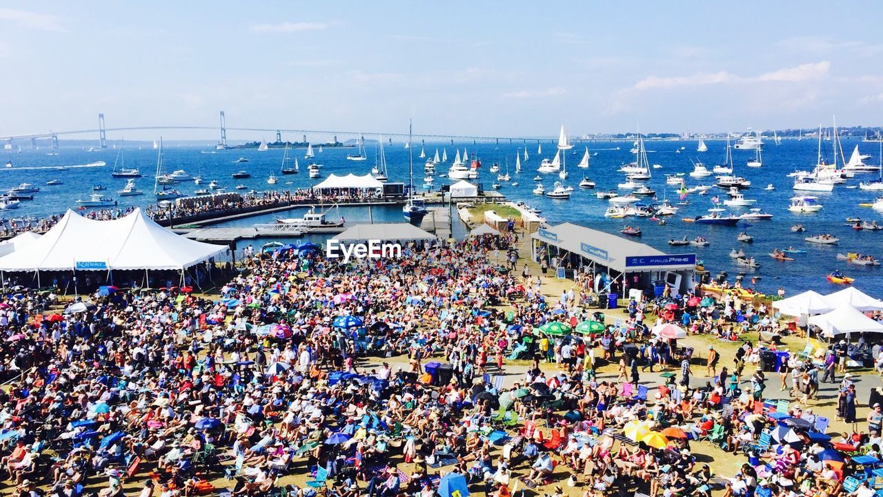 crowd, large group of people, high angle view, day, outdoors, water, sky, men, women, architecture, real people, stadium, city, people