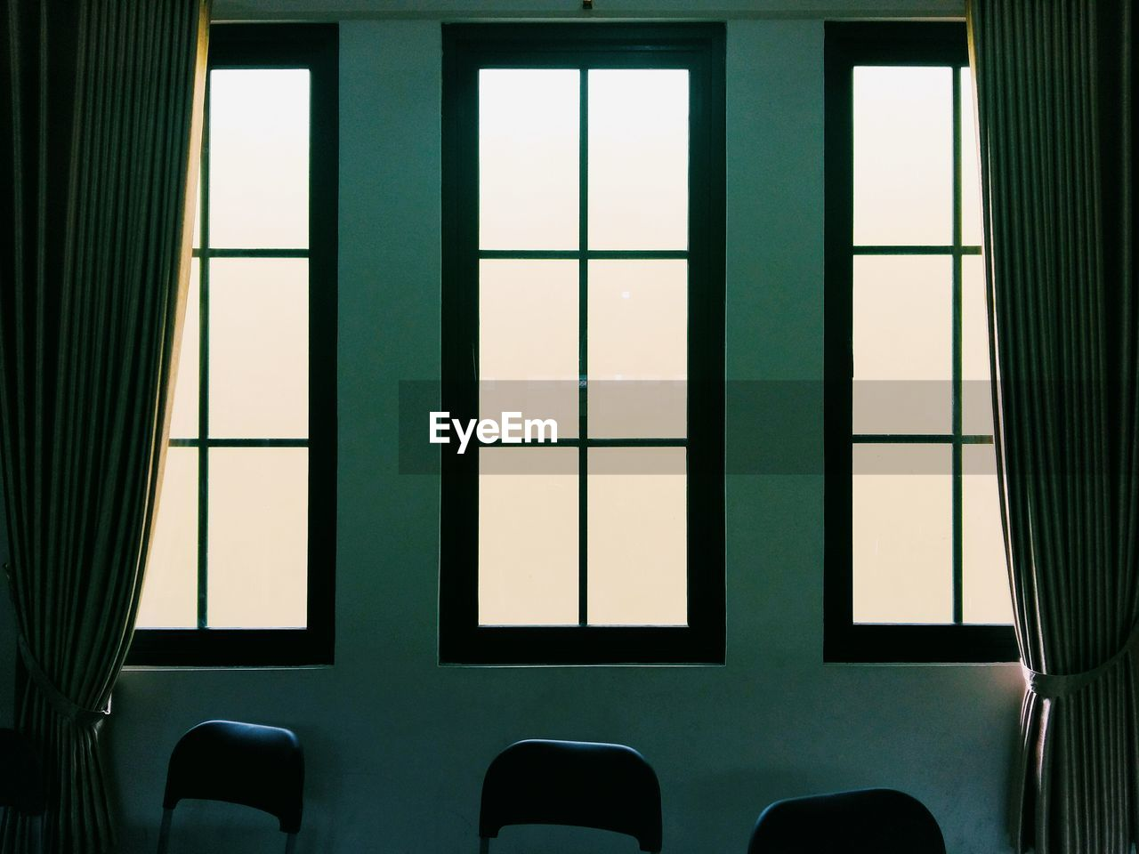 window, indoors, no people, seat, glass - material, day, built structure, architecture, transparent, close-up, absence, chair, domestic room, illuminated, empty, geometric shape, building, pattern, green color, window frame