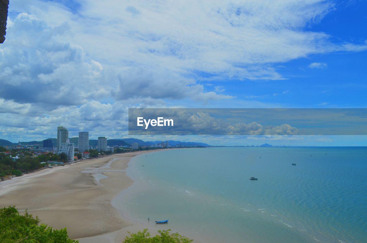 Idyllic shot of beach against blue sky