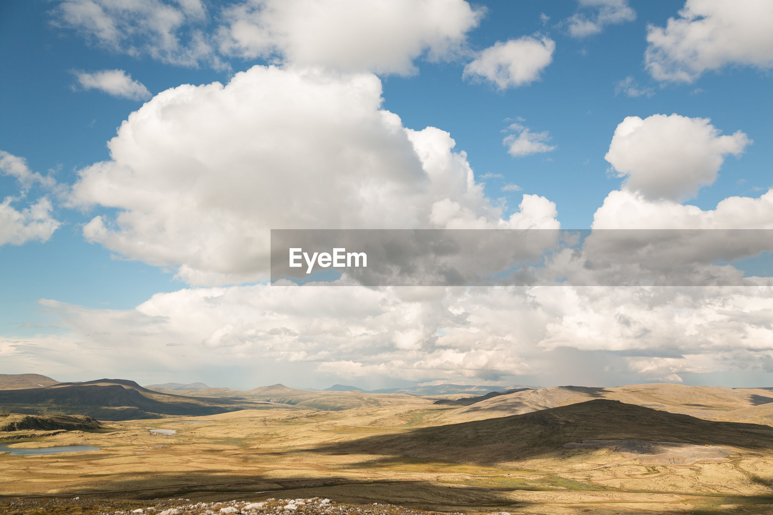 SCENIC VIEW OF CLOUDS OVER MOUNTAIN