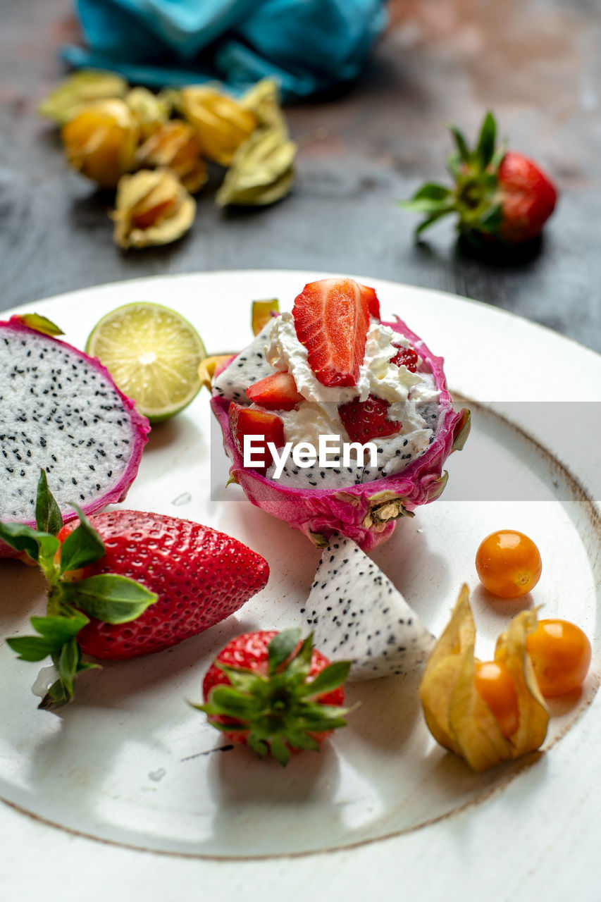food and drink, food, freshness, fruit, still life, berry fruit, healthy eating, strawberry, table, indoors, plate, high angle view, ready-to-eat, no people, temptation, indulgence, close-up, sweet food, wellbeing, sweet, garnish, orange