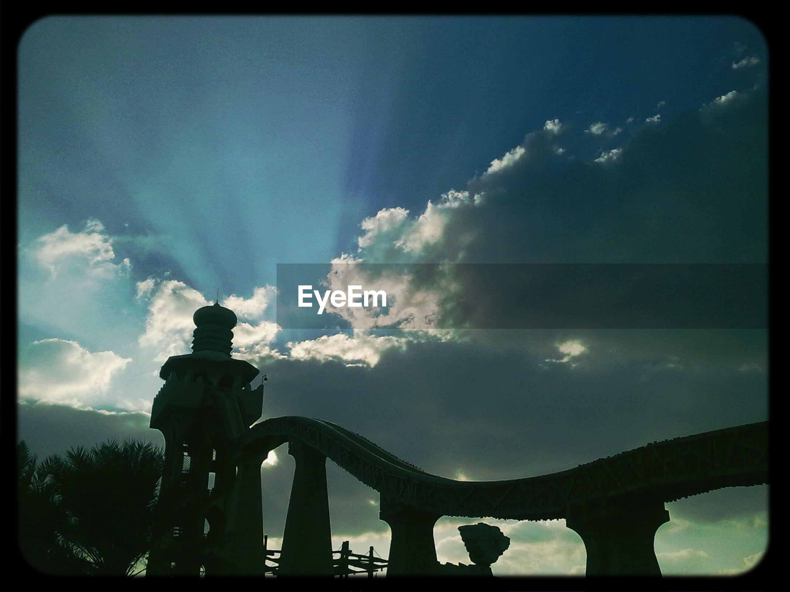 transfer print, sky, low angle view, built structure, auto post production filter, cloud - sky, silhouette, architecture, cloud, bridge - man made structure, connection, cloudy, outdoors, bridge, railing, nature, engineering, architectural column, no people, sunlight