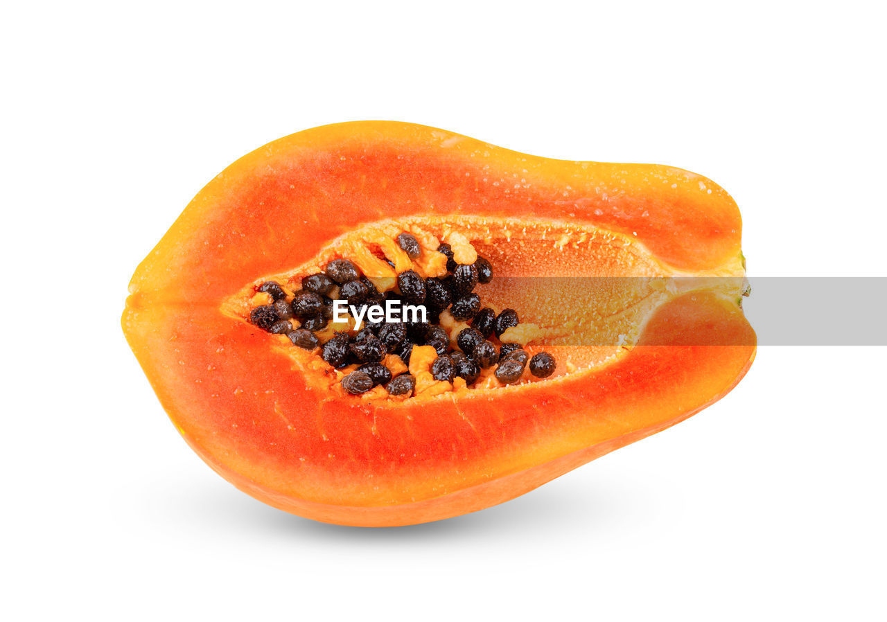 food, studio shot, healthy eating, fruit, food and drink, wellbeing, freshness, still life, white background, orange color, papaya, cross section, seed, indoors, slice, cut out, close-up, tropical fruit, no people, single object, ripe
