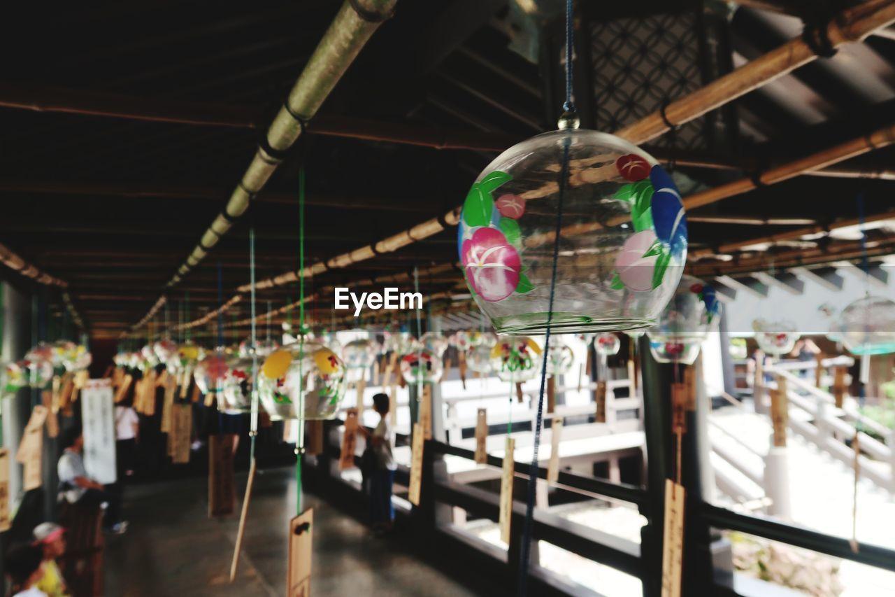Close-Up Of Lanterns Hanging In Shrine
