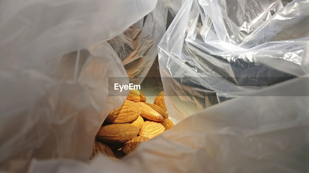 Close-Up Of Almonds In Bag