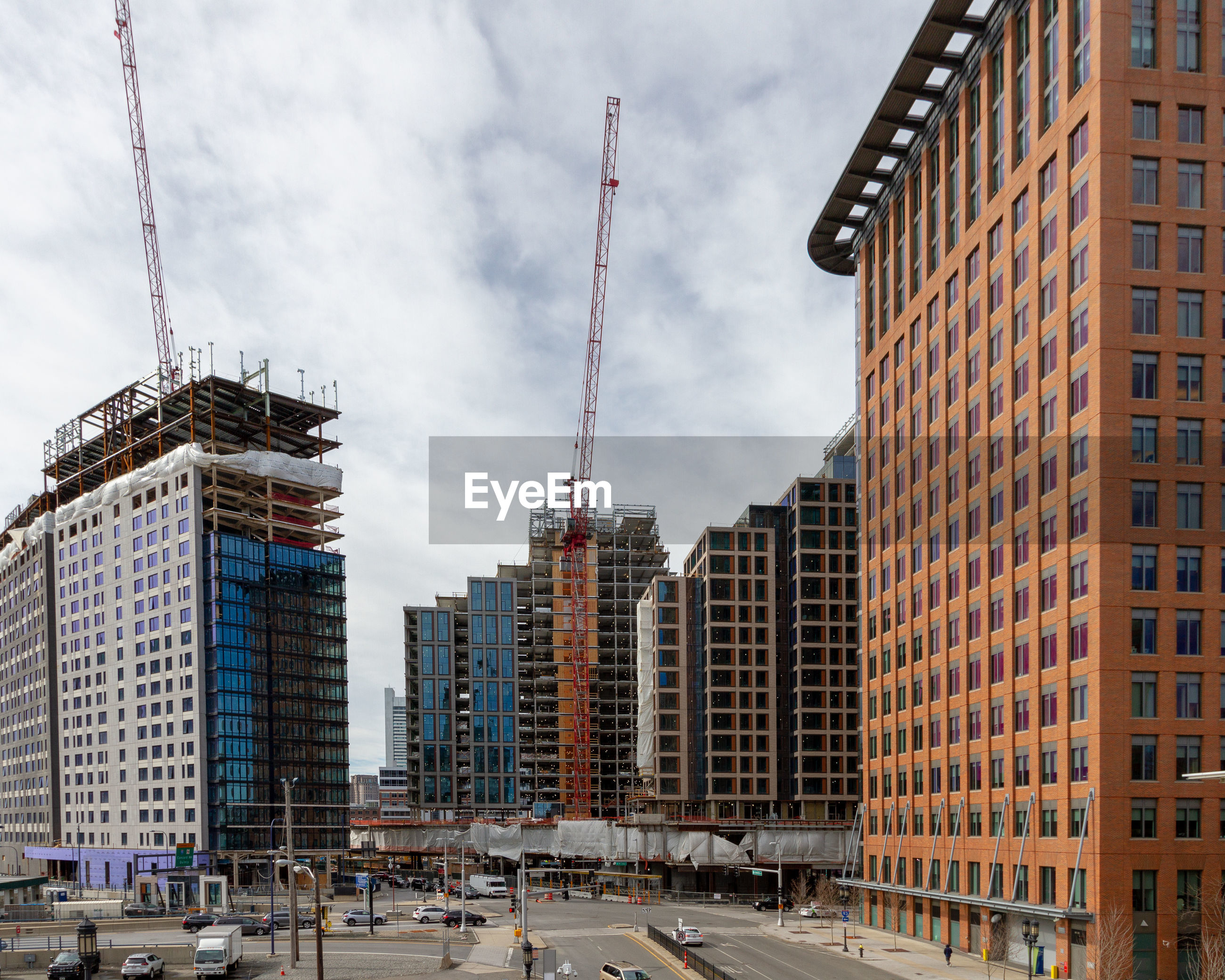 Low angle view of buildings and construction against sky. boston