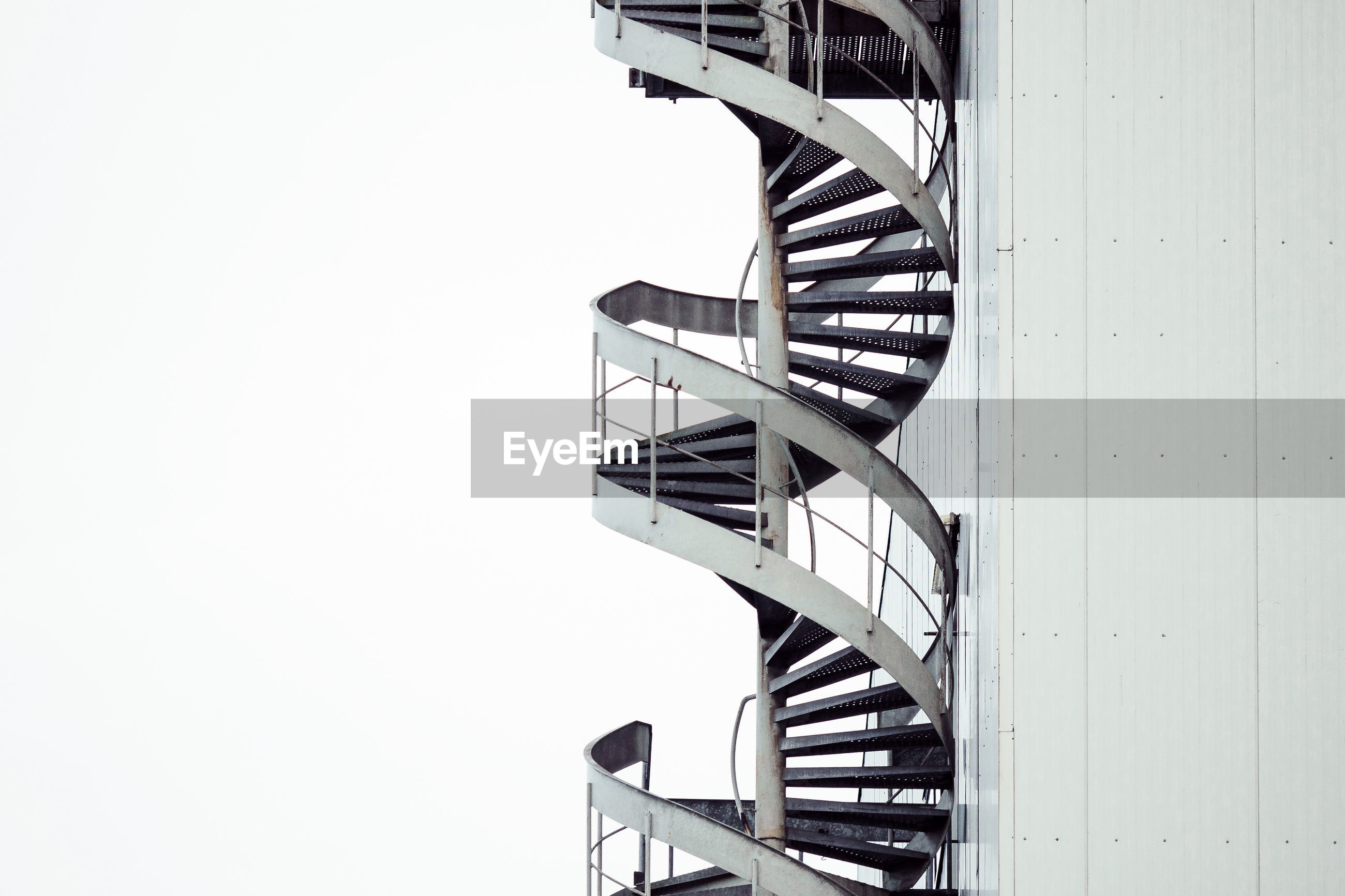 View of spiral stairs against clear sky