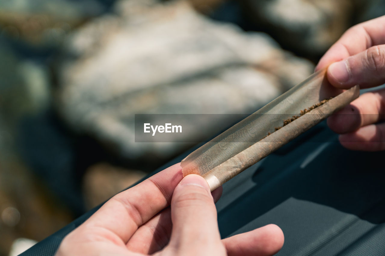 human hand, hand, one person, real people, human body part, holding, focus on foreground, unrecognizable person, finger, human finger, lifestyles, art and craft, occupation, close-up, body part, selective focus, craft, wood - material, work tool