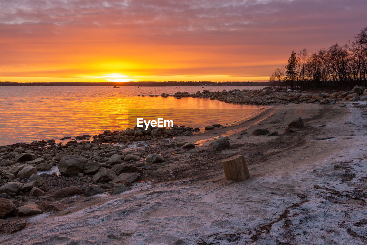 sunset, sky, water, scenics - nature, orange color, beauty in nature, rock, tranquility, tranquil scene, solid, rock - object, cloud - sky, nature, sea, no people, non-urban scene, idyllic, beach, land