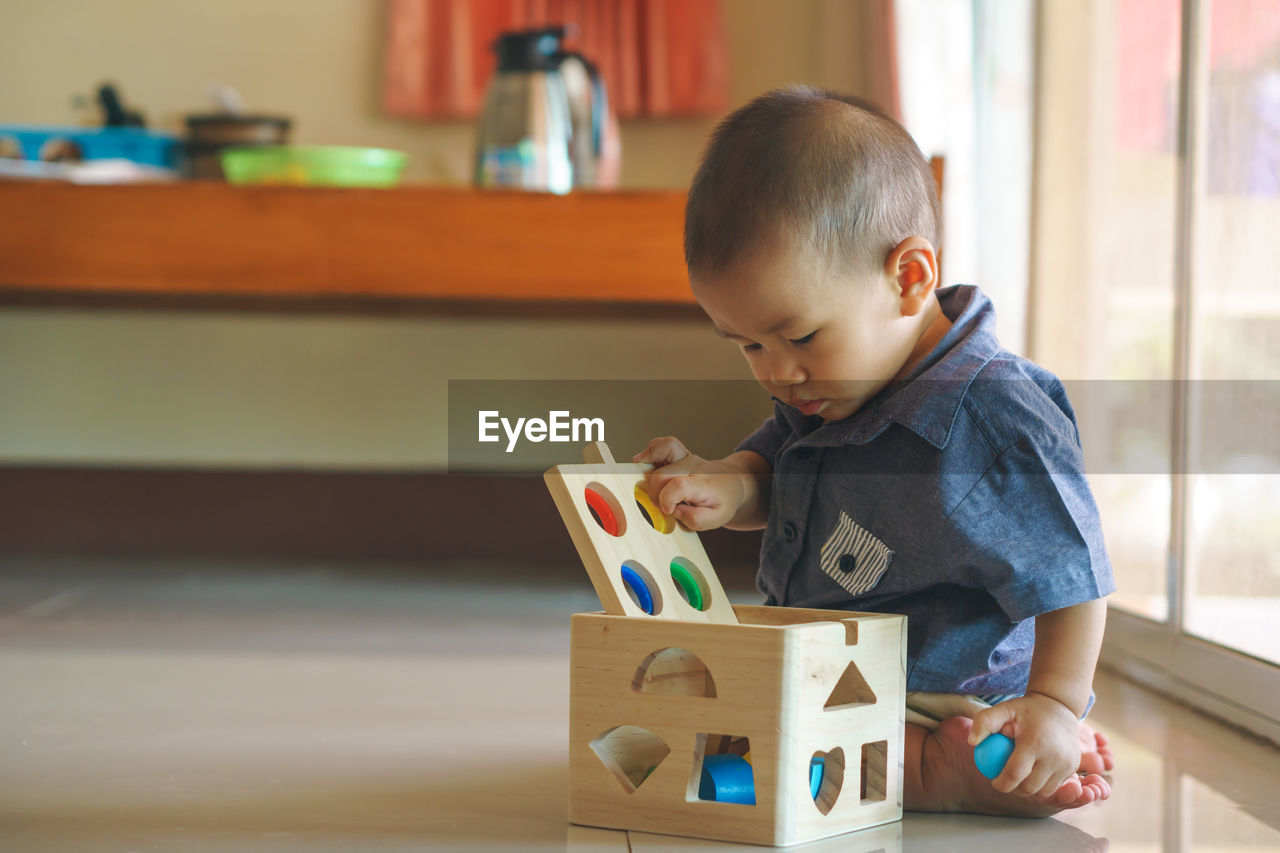 Cute Boy Playing With Toys At Home