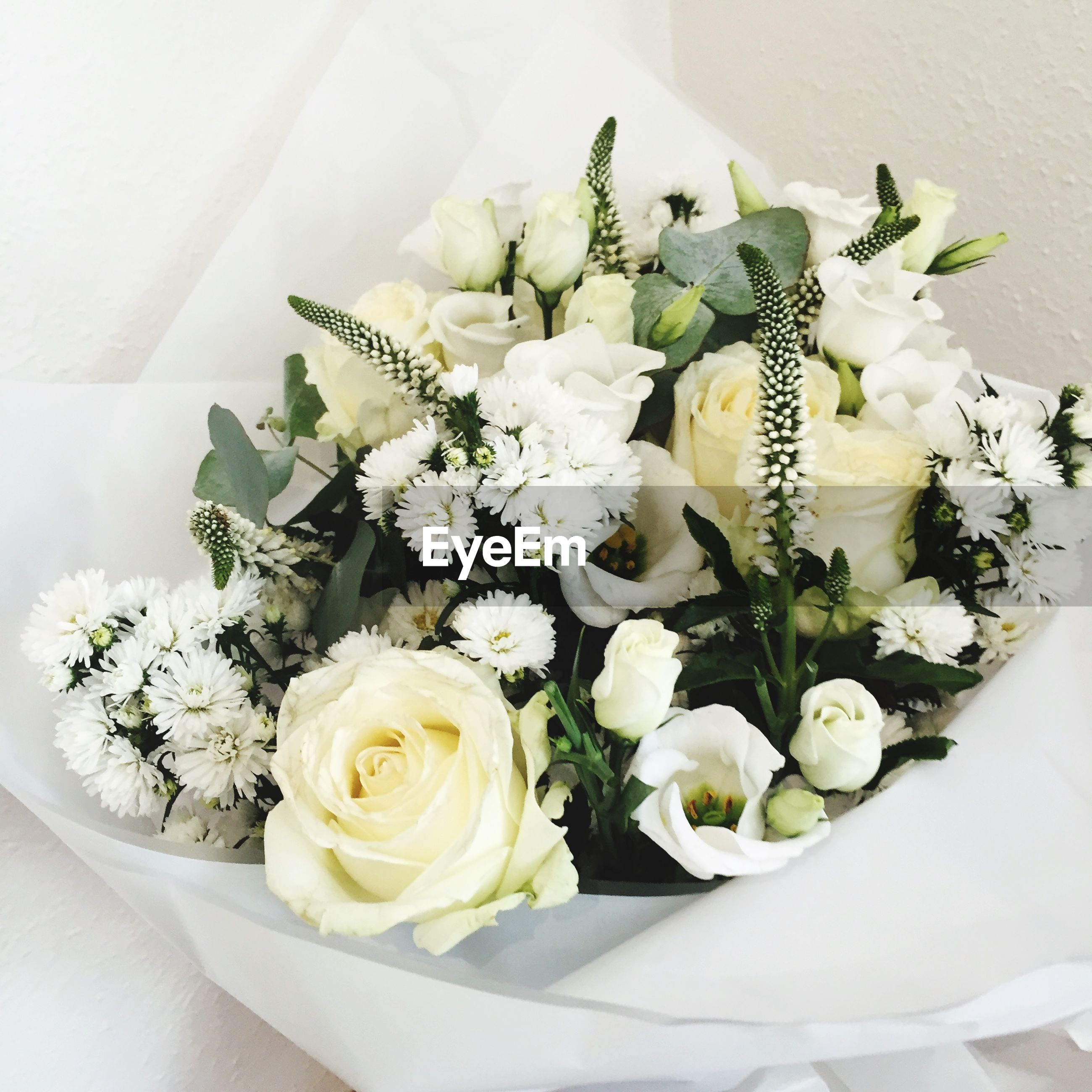 flower, indoors, freshness, high angle view, bouquet, fragility, petal, table, still life, flower head, white color, vase, bunch of flowers, close-up, plant, variation, decoration, beauty in nature, flower arrangement, directly above