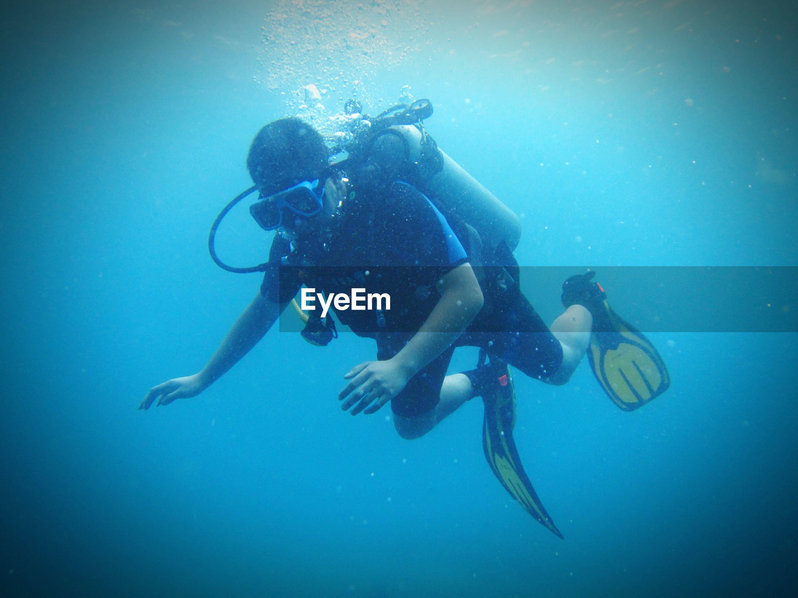Full length of scuba diver in sea