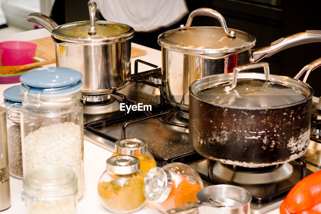 High Angle View Of Cooking Pans On Gas In Kitchen