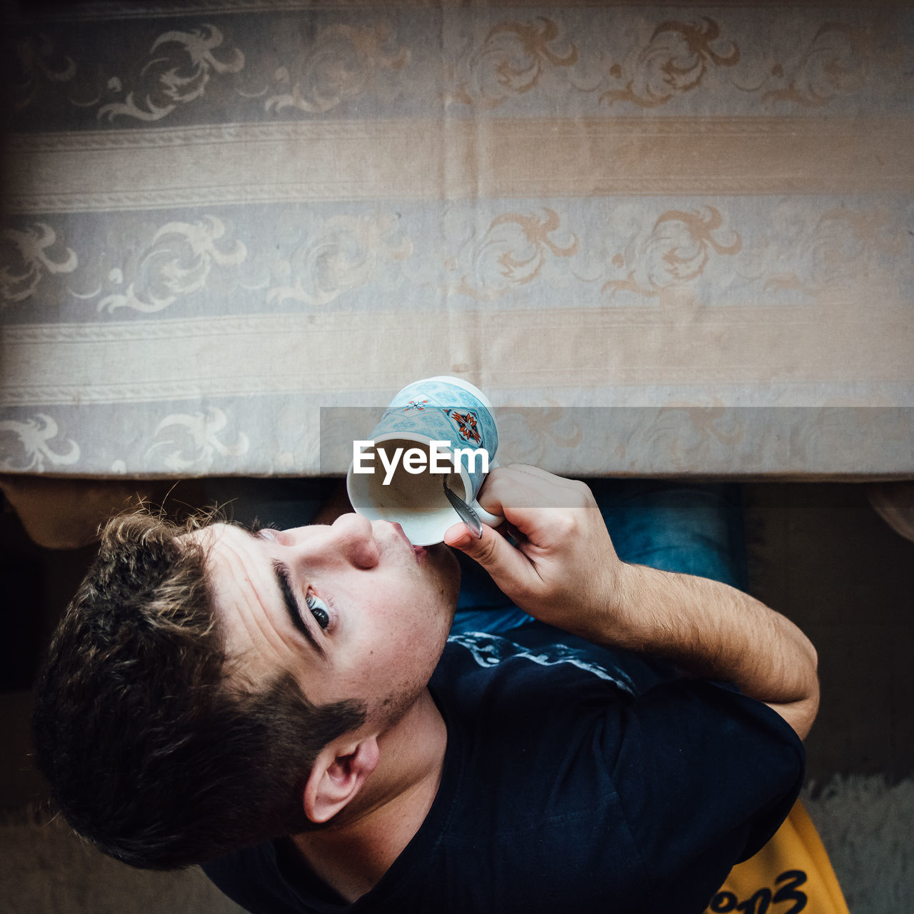 High Angle View Of Man Drinking Coffee