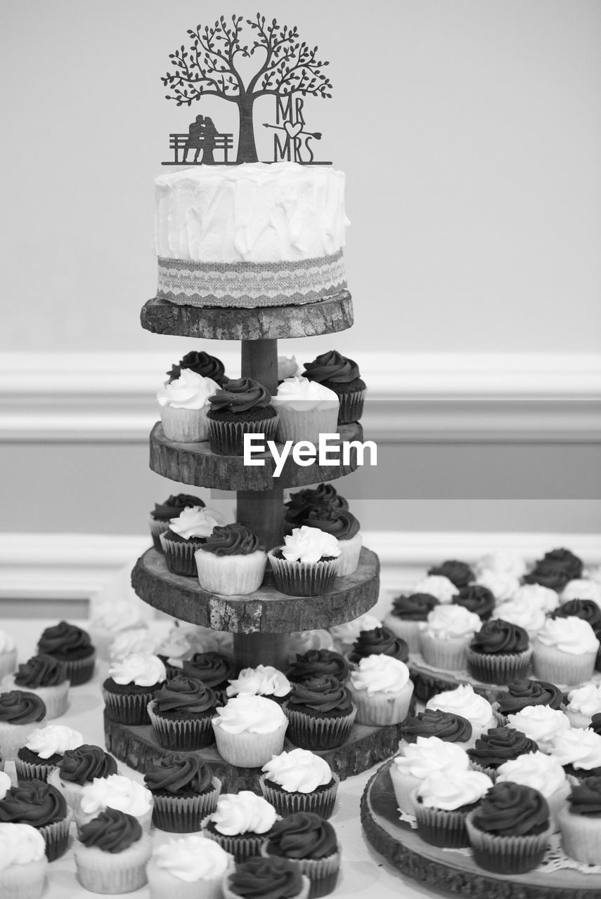sweet food, cake, dessert, sweet, indulgence, food and drink, baked, food, temptation, unhealthy eating, cupcake, no people, indoors, freshness, table, still life, ready-to-eat, cakestand, large group of objects, wedding cake, cupcake holder