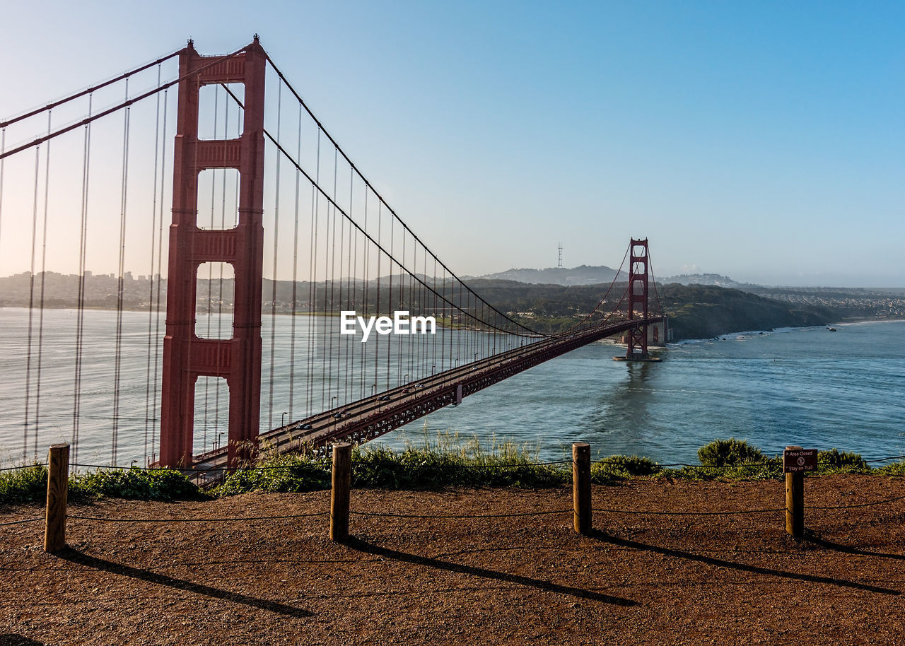 built structure, sky, architecture, water, transportation, suspension bridge, bridge, connection, bridge - man made structure, nature, bay, engineering, travel destinations, tourism, bay of water, travel, sea, clear sky, outdoors
