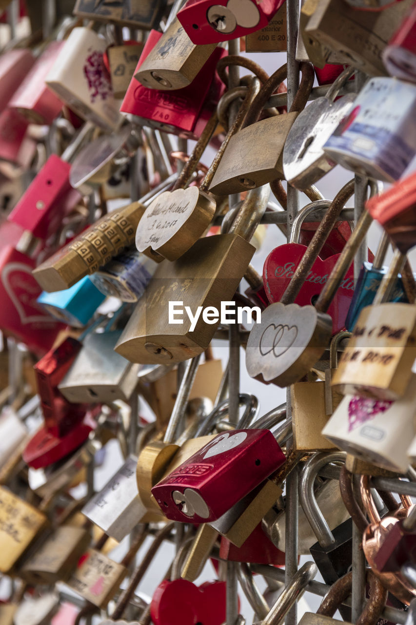 large group of objects, lock, padlock, abundance, love lock, love, hanging, no people, positive emotion, metal, variation, hope - concept, close-up, railing, protection, safety, selective focus, emotion, hope, security, outdoors