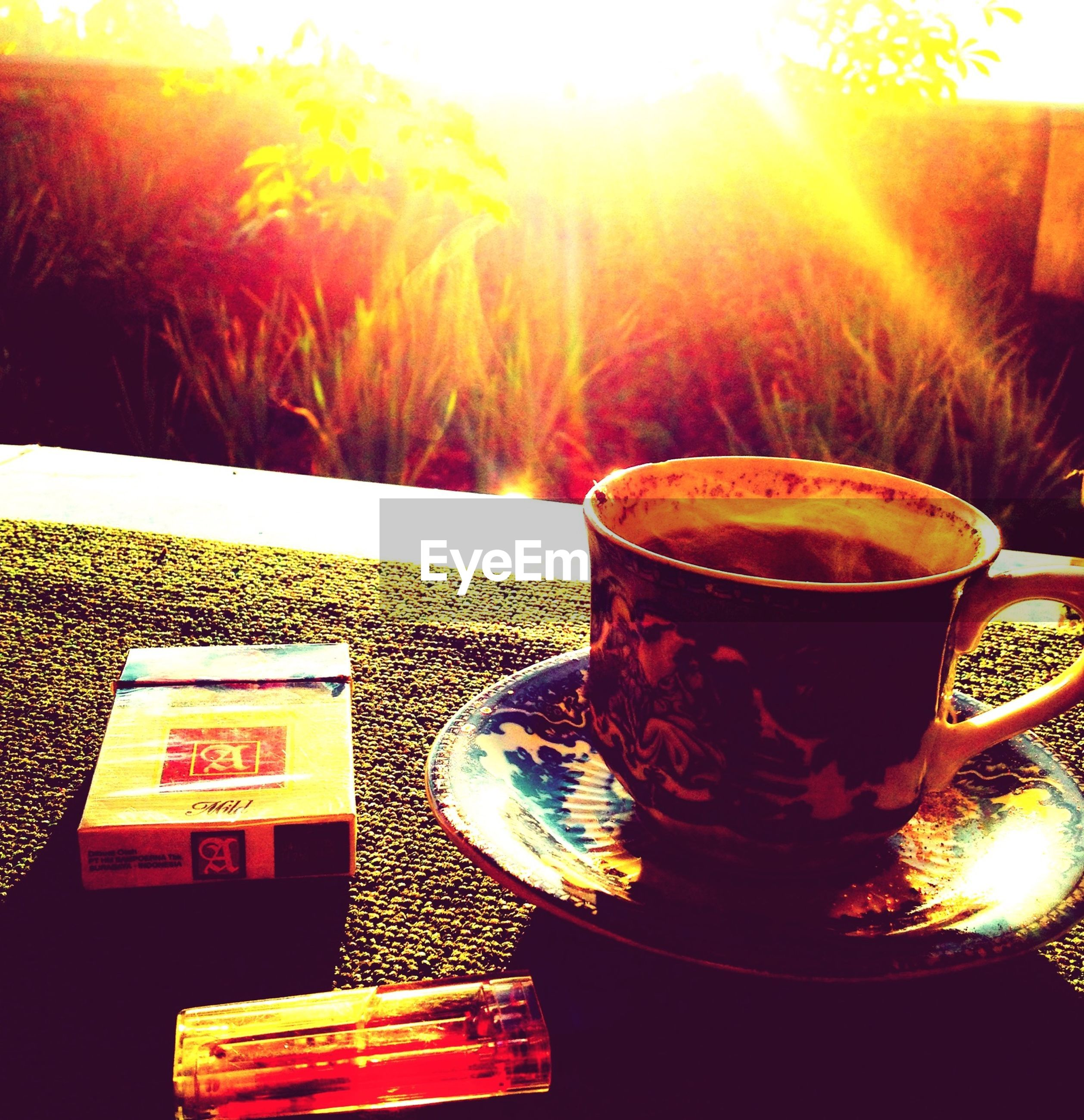 food and drink, drink, flame, sunbeam, burning, sunlight, heat - temperature, indoors, table, sun, close-up, fire - natural phenomenon, freshness, candle, refreshment, lens flare, still life, glowing, no people, orange color