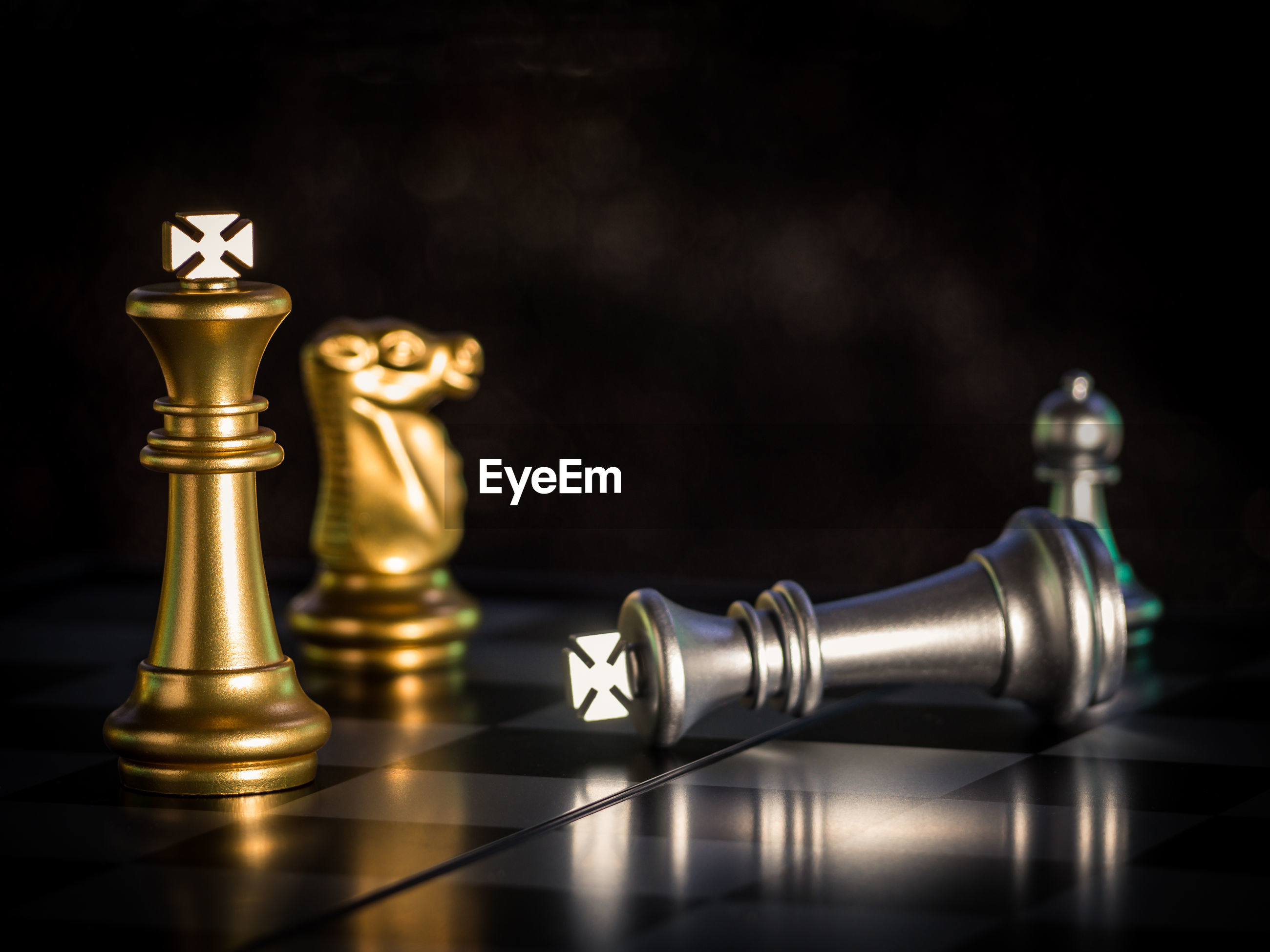 CLOSE-UP OF CHESS PIECES ON FLOOR