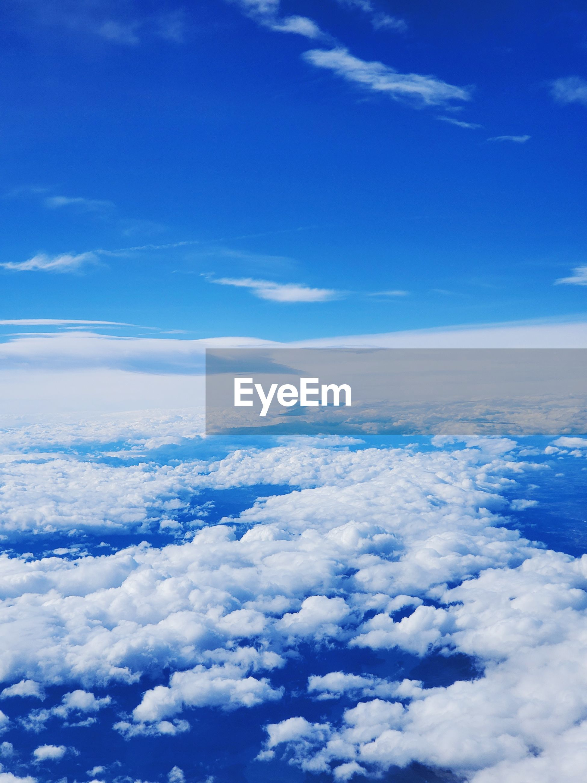 LOW ANGLE VIEW OF CLOUDS OVER BLUE SKY