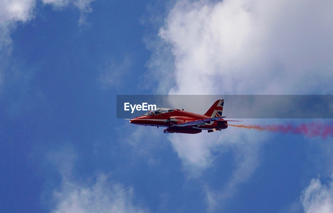cloud - sky, sky, mode of transportation, air vehicle, low angle view, nature, transportation, day, airplane, smoke - physical structure, on the move, flying, red, motion, travel, flag, outdoors, freedom, no people, patriotism, plane, independence, national icon