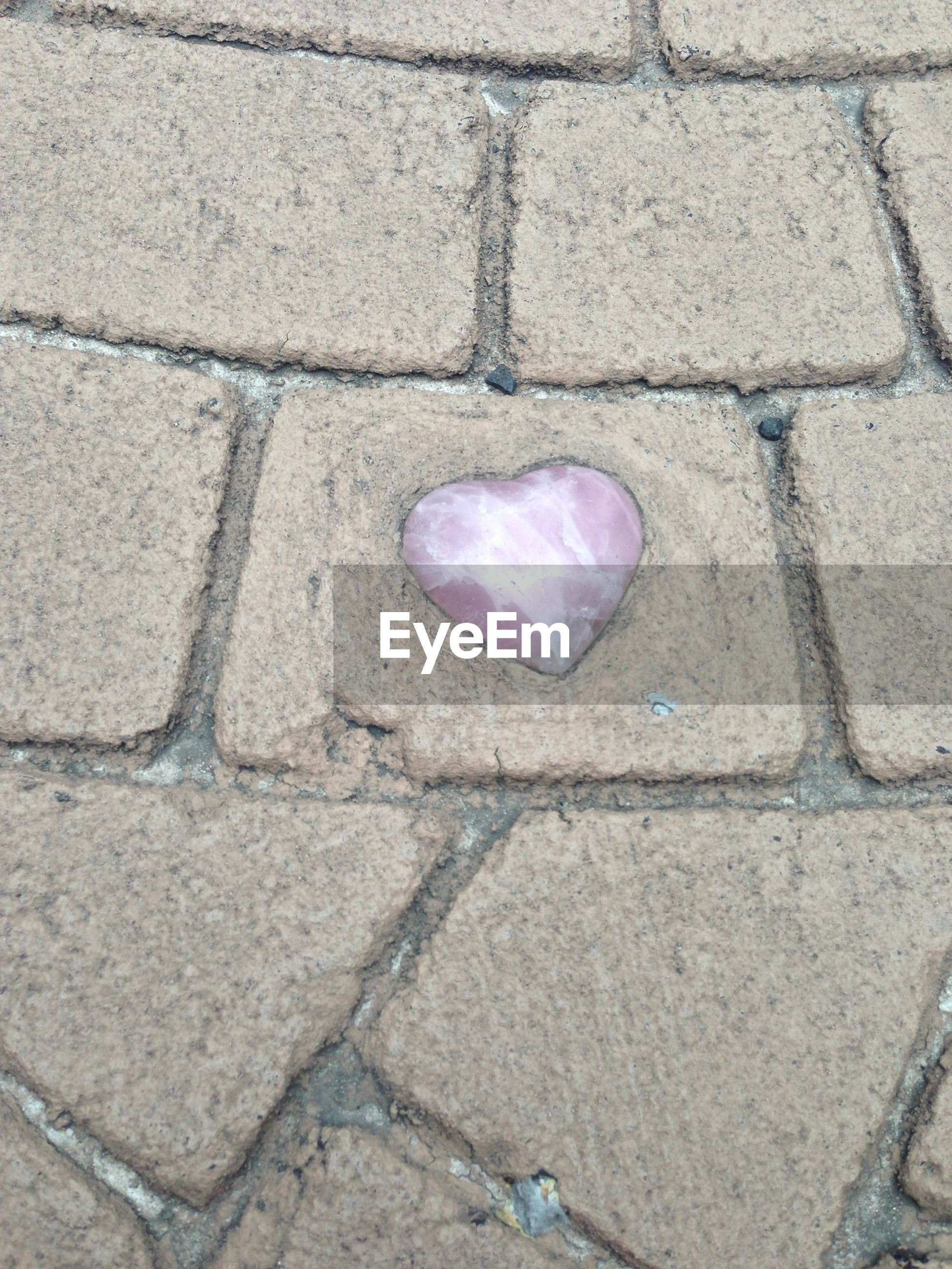 high angle view, textured, street, close-up, day, outdoors, cobblestone, stone - object, no people, pattern, fragility, pink color, sidewalk, nature, cracked, full frame, still life, ground, footpath, backgrounds