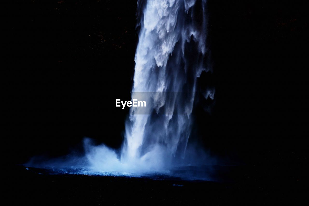 motion, night, heat - temperature, long exposure, nature, no people, water, scenics - nature, geology, smoke - physical structure, blurred motion, splashing, erupting, beauty in nature, outdoors, dark, sky, environment, black background, power in nature, flowing water, flowing