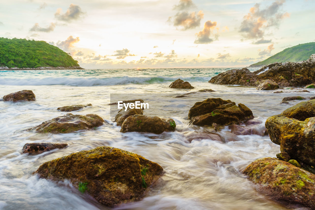 water, beauty in nature, rock, sea, rock - object, scenics - nature, solid, sky, land, motion, cloud - sky, nature, beach, no people, tranquil scene, day, long exposure, sport, blurred motion, outdoors, flowing water, flowing
