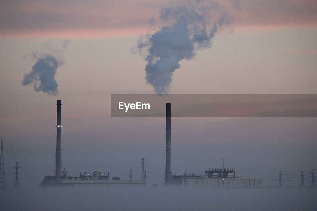 smoke stack, environmental issues, industry, factory, smoke - physical structure, pollution, emitting, sky, building exterior, chimney, air pollution, environment, built structure, smoke, fumes, architecture, chemical, fuel and power generation, chemistry, ecosystem, no people, atmospheric, outdoors, smog