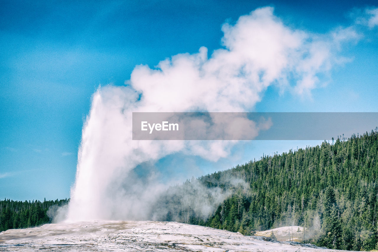 Old faithful geyser erupting in yellowstone national park, usa