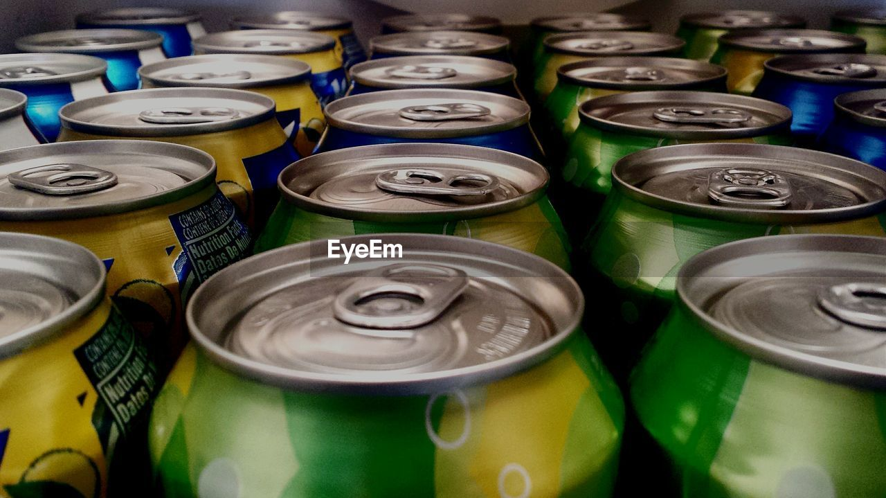 Close-up of drinking cans