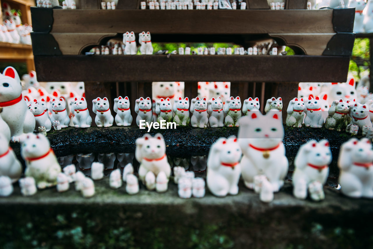 in a row, large group of objects, no people, variation, table, for sale, indoors, day, figurine, arrangement, close-up, retail, chess board, chess piece, chess