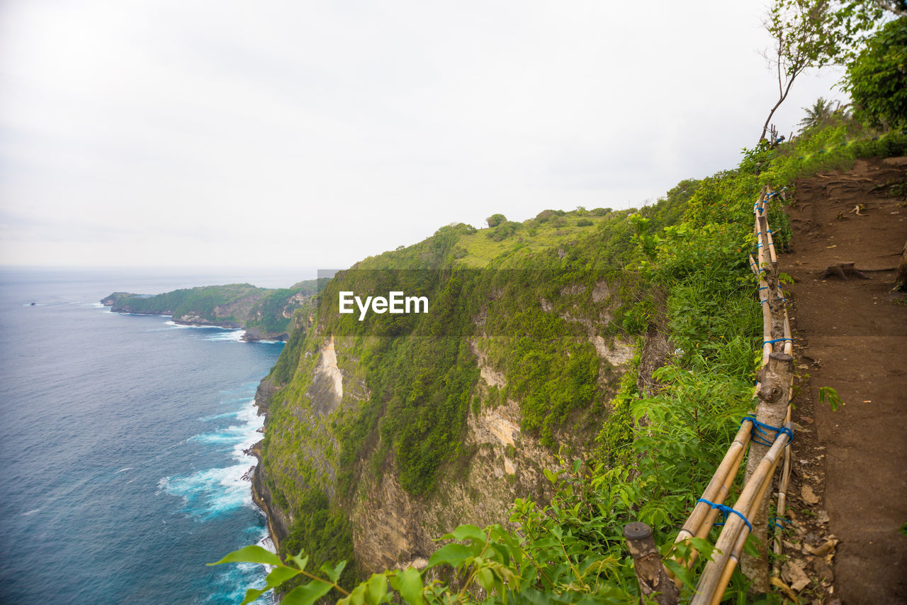nature, mountain, beauty in nature, scenics, outdoors, day, no people, tranquil scene, sea, tranquility, sky, landscape, cliff, water