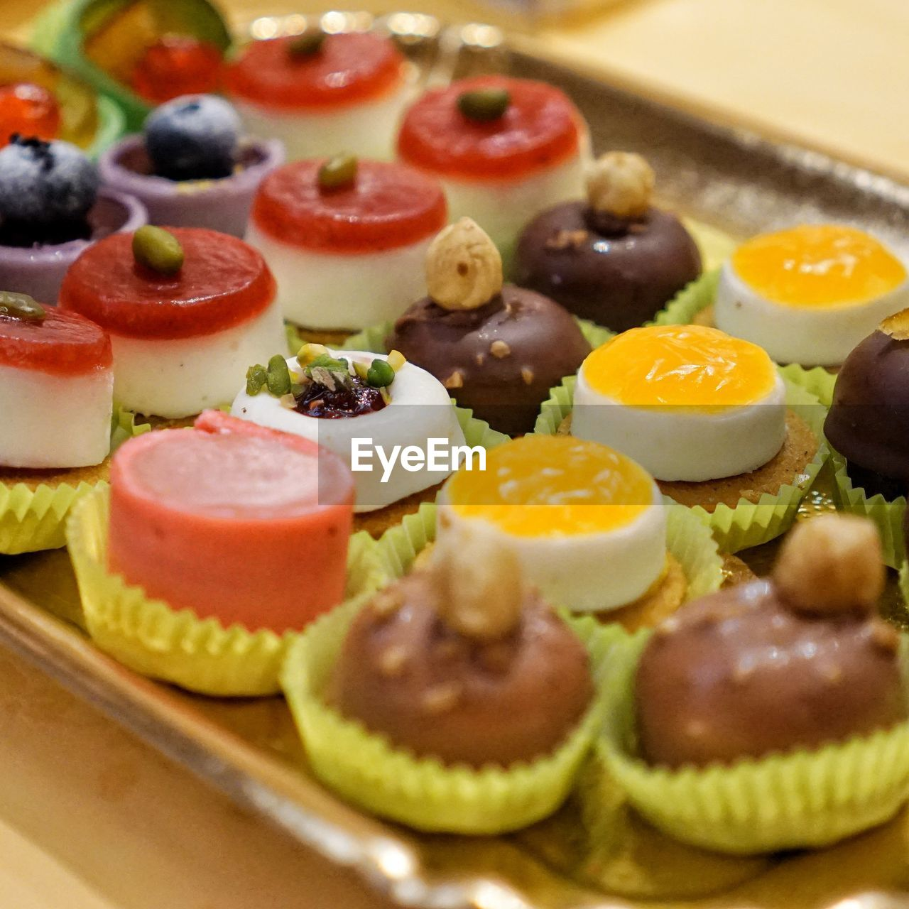 food, food and drink, freshness, still life, ready-to-eat, sweet food, indoors, healthy eating, sweet, dessert, indulgence, close-up, no people, fruit, temptation, selective focus, in a row, wellbeing, table, choice, tart - dessert, breakfast, tray