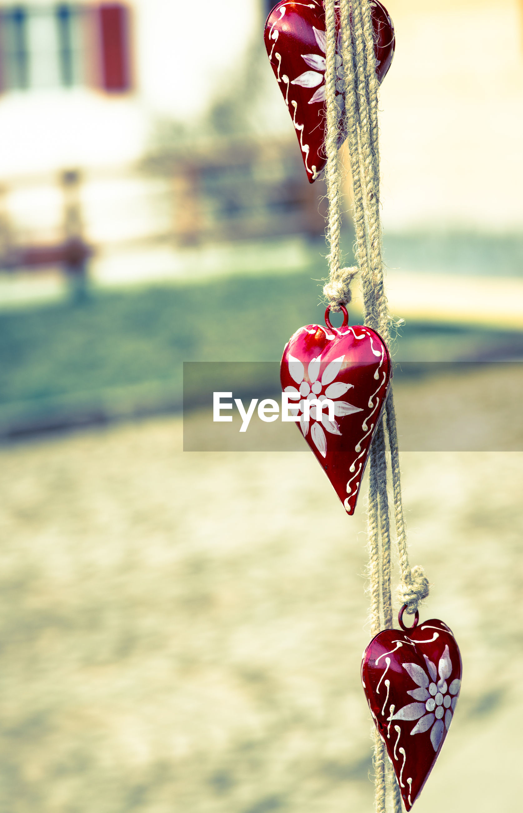 Heart shape decorations hanging on ropes