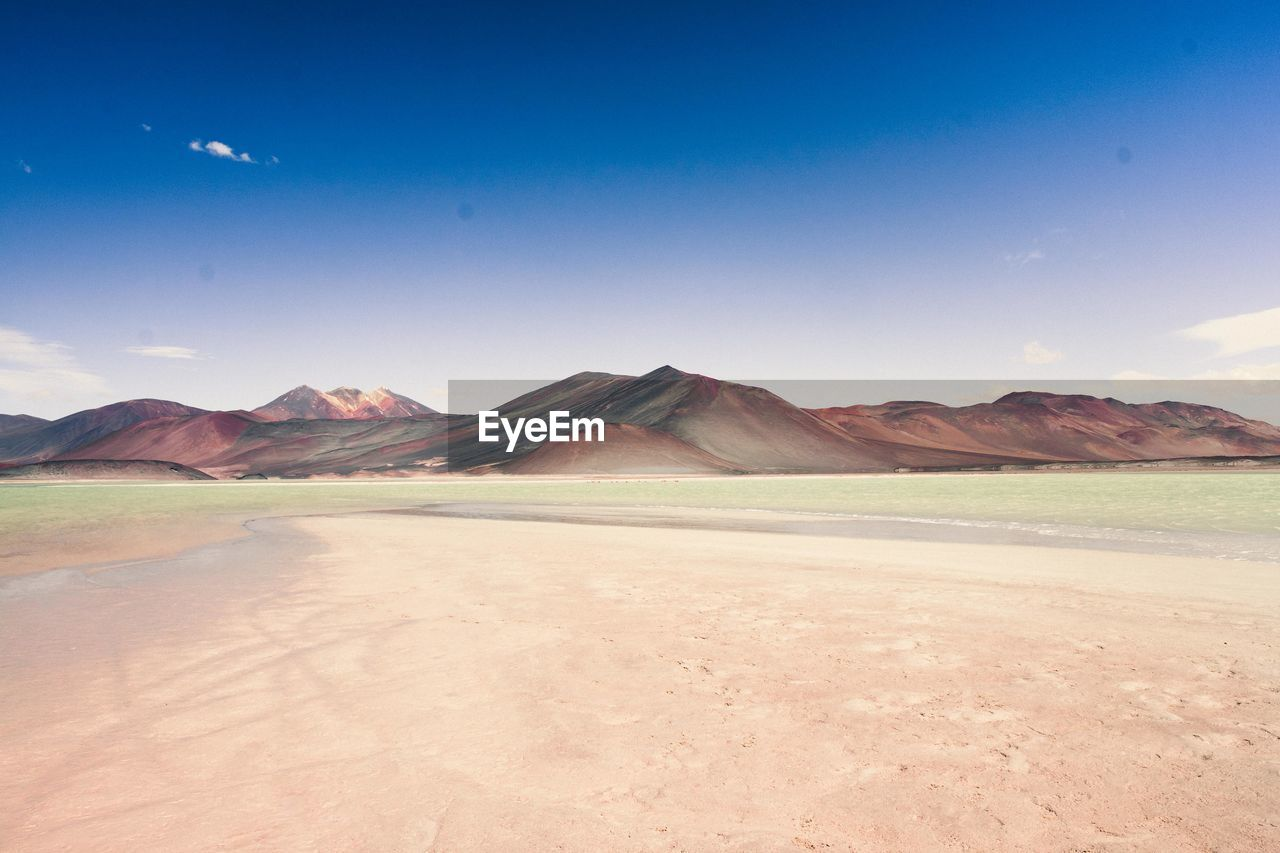 mountain, scenics - nature, sky, beauty in nature, tranquil scene, tranquility, environment, landscape, non-urban scene, nature, no people, mountain range, blue, day, land, remote, idyllic, cloud - sky, water, outdoors, salt flat, arid climate, climate, mountain peak