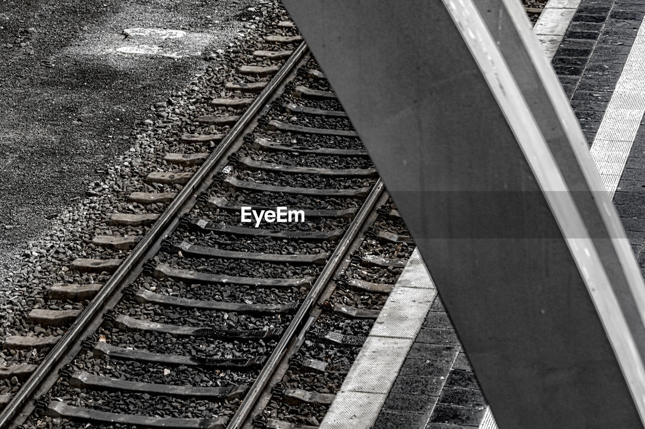railroad track, transportation, rail transportation, railroad tie, day, high angle view, metal, outdoors, no people, railroad, public transportation, parallel