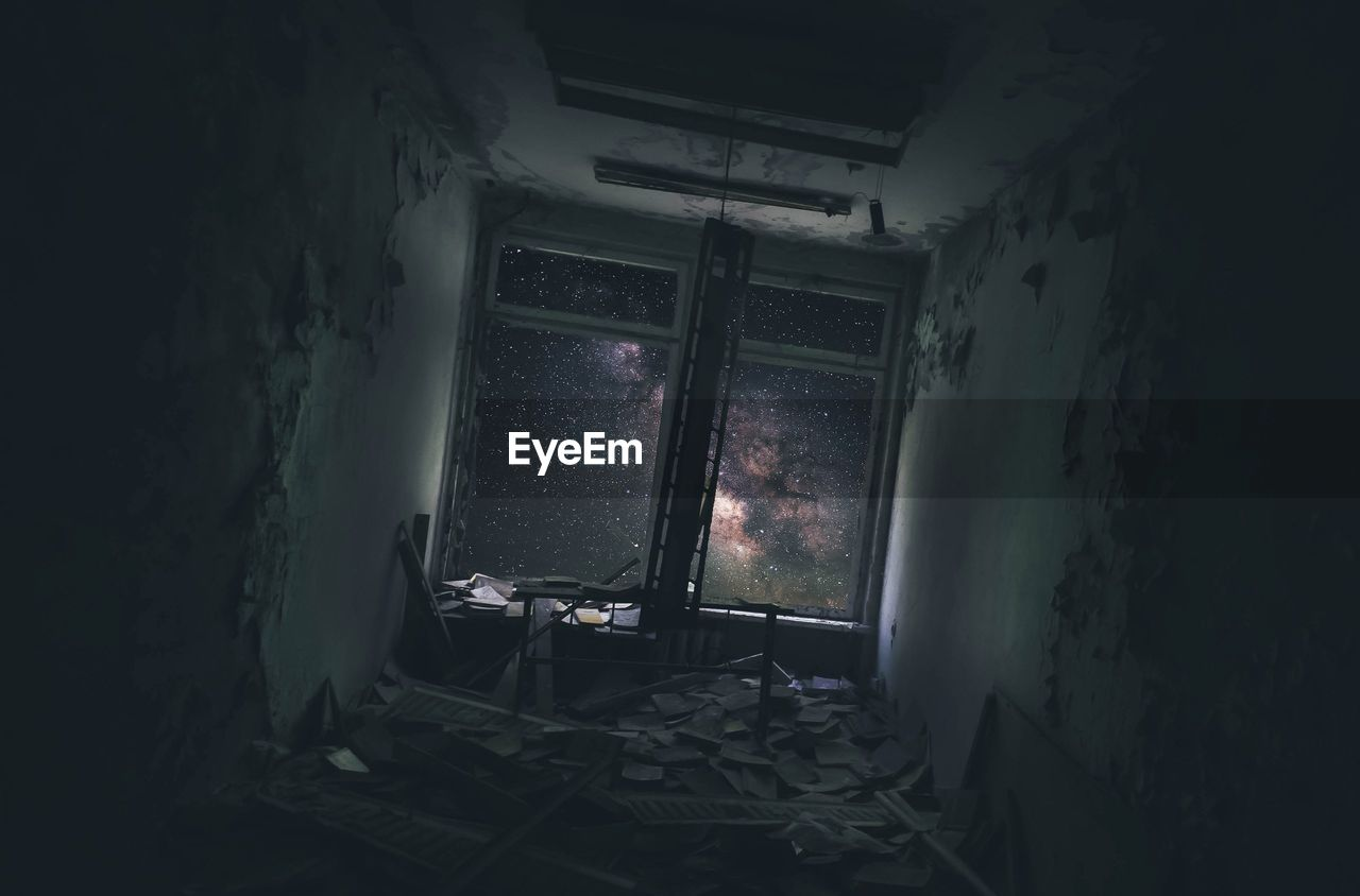 Stars seen through window in abandoned room