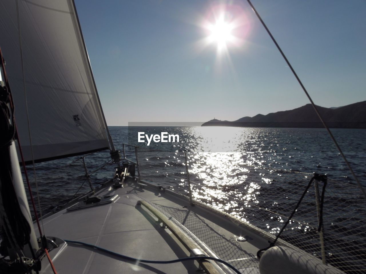 sea, sunlight, sun, water, nautical vessel, sailing, beauty in nature, mode of transport, sailboat, nature, transportation, scenics, no people, yacht, sky, outdoors, day, horizon over water, clear sky, boat deck, yachting