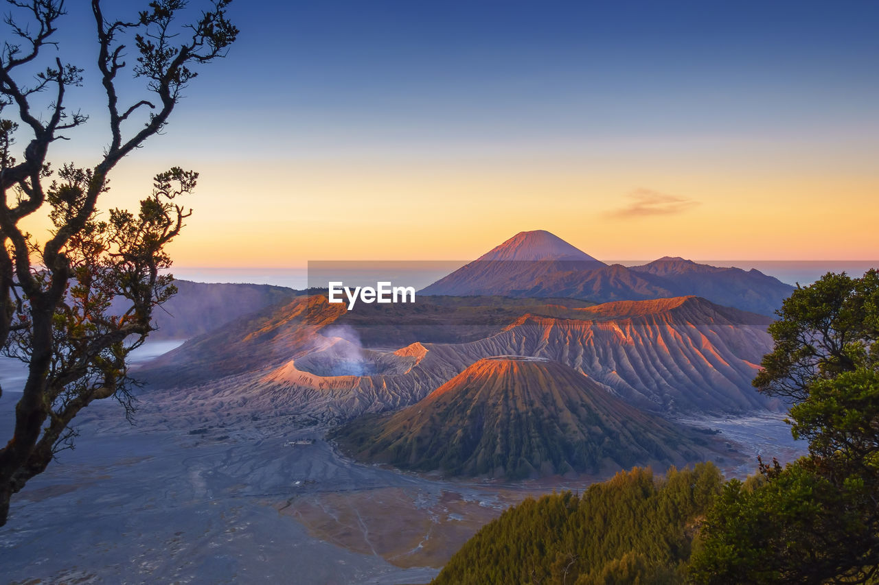 Scenic View Of Volcano Mountains Against Sky During Sunset