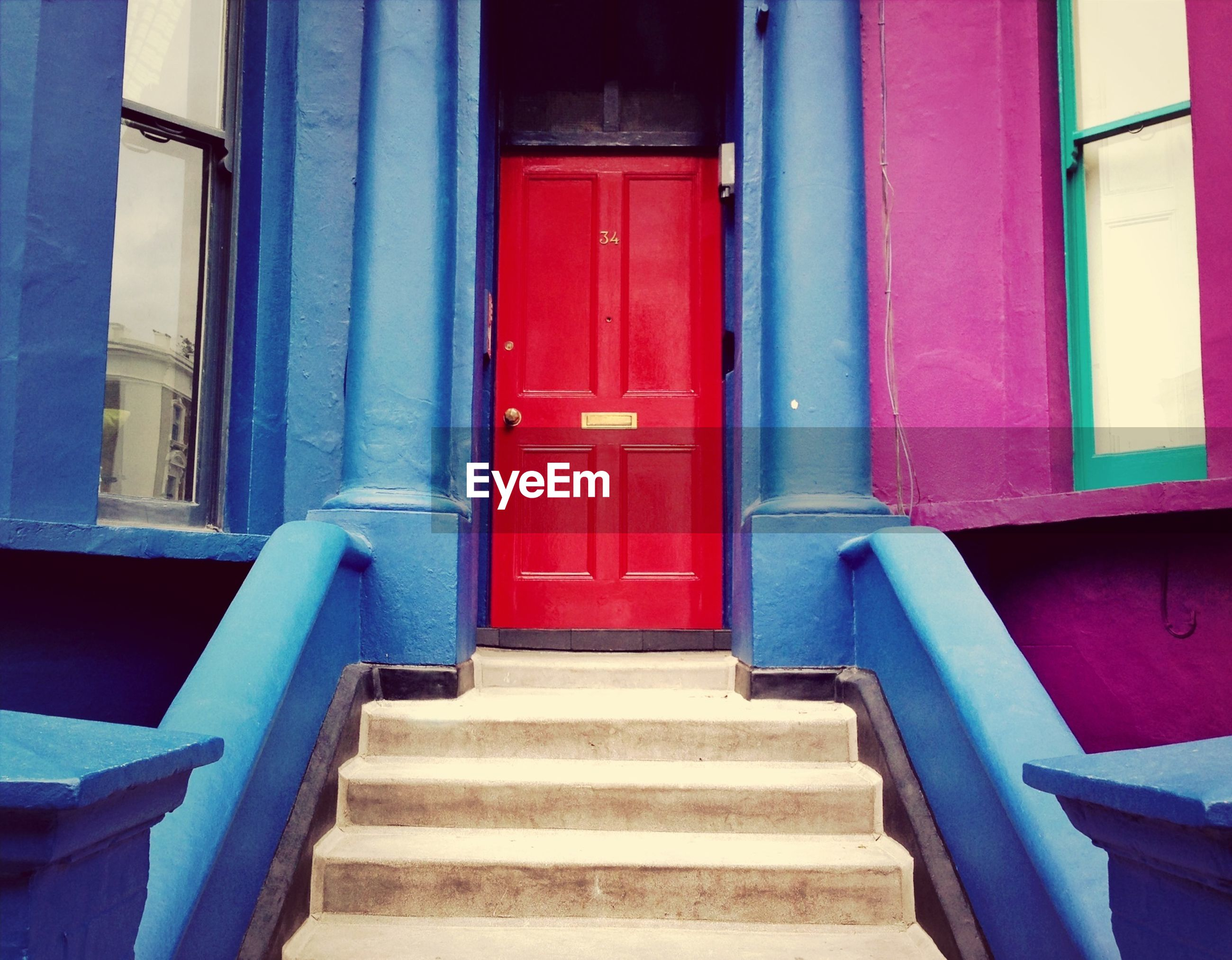 built structure, architecture, building exterior, steps, door, staircase, railing, steps and staircases, blue, red, closed, entrance, house, stairs, window, residential structure, building, day, no people, wall