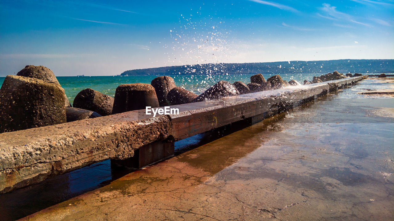 water, nature, beauty in nature, sea, rock - object, outdoors, sky, day, no people, scenics, sunlight, horizon over water