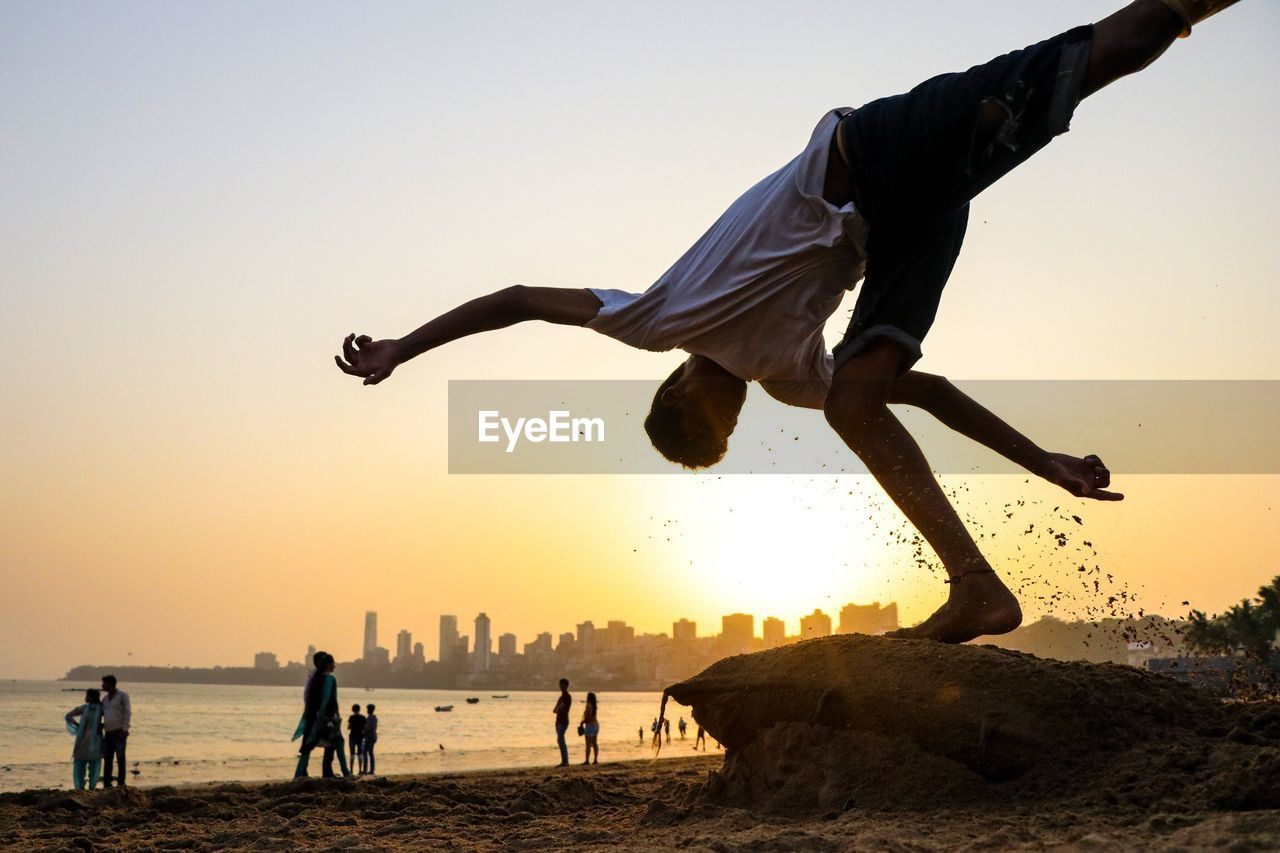 PEOPLE AT BEACH DURING SUNSET