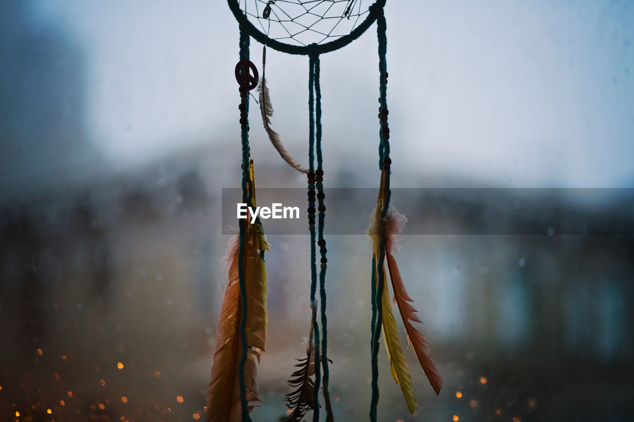 Handmade dreamcatcher, made by husband, hanging in our window on a another rainy evening