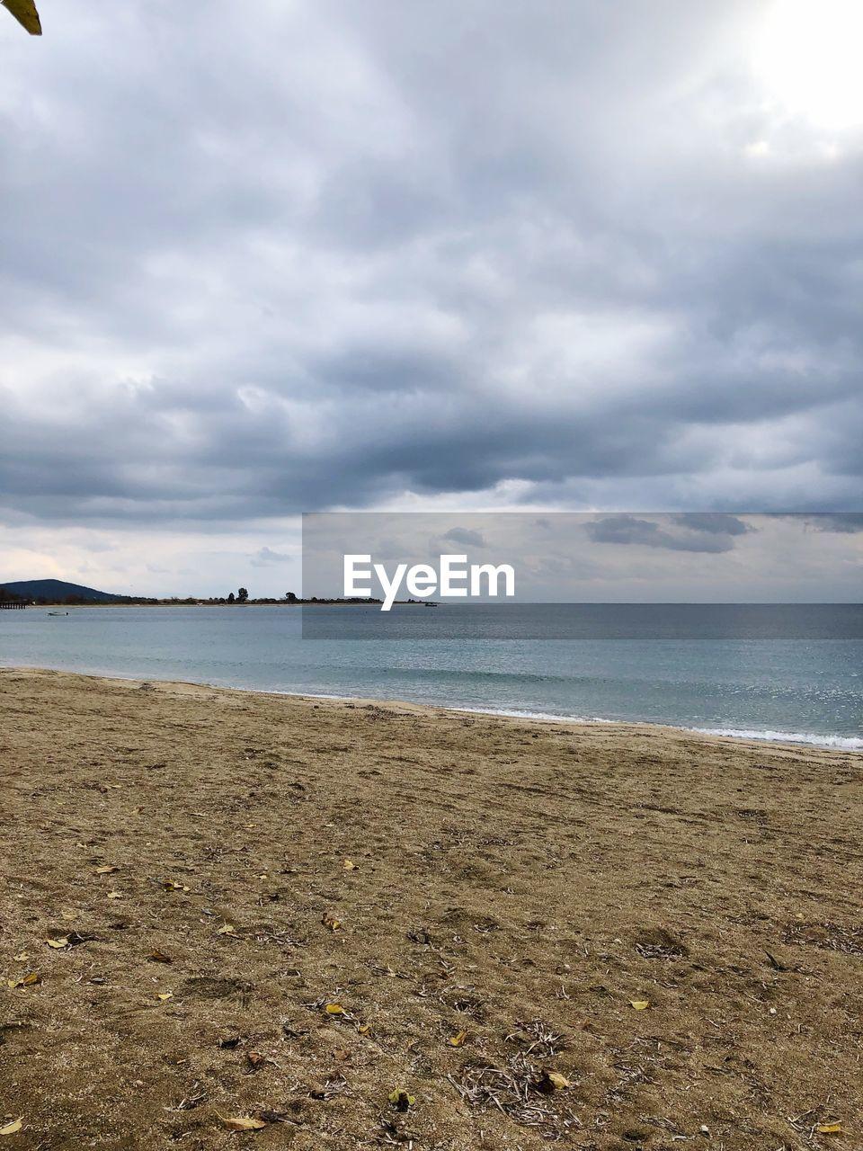 sea, water, sky, land, beach, cloud - sky, scenics - nature, beauty in nature, horizon over water, tranquil scene, horizon, sand, tranquility, nature, day, no people, outdoors, non-urban scene, idyllic