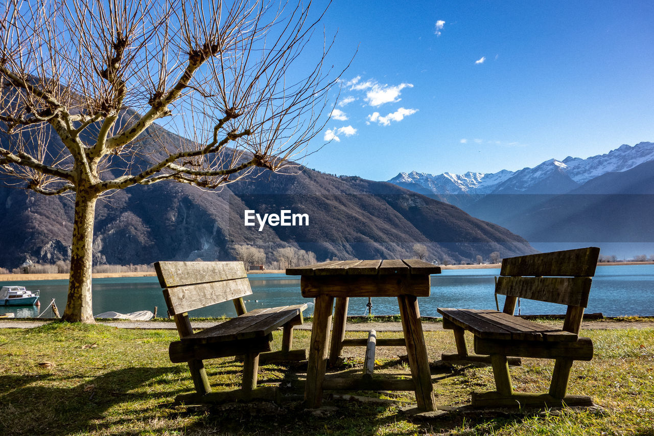 mountain, beauty in nature, seat, nature, scenics - nature, mountain range, tranquil scene, tranquility, tree, day, cold temperature, idyllic, table, sky, snow, no people, plant, winter, bench, non-urban scene, outdoors, snowcapped mountain