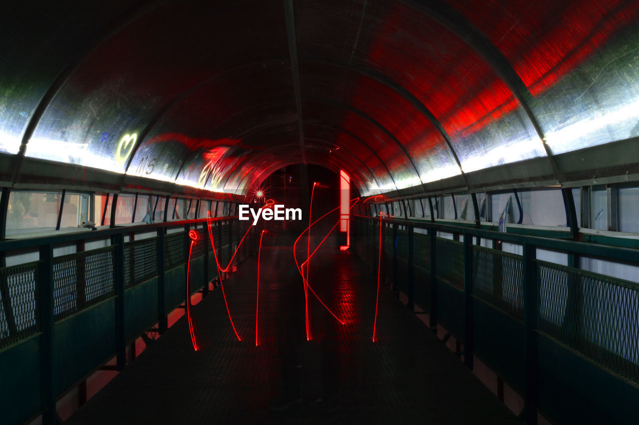 People in illuminated tunnel