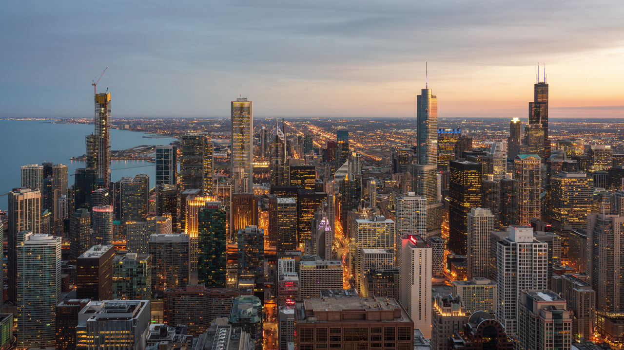 architecture, building exterior, city, built structure, cityscape, building, skyscraper, tall - high, sky, office building exterior, modern, tower, residential district, no people, cloud - sky, travel destinations, urban skyline, nature, outdoors, financial district, spire