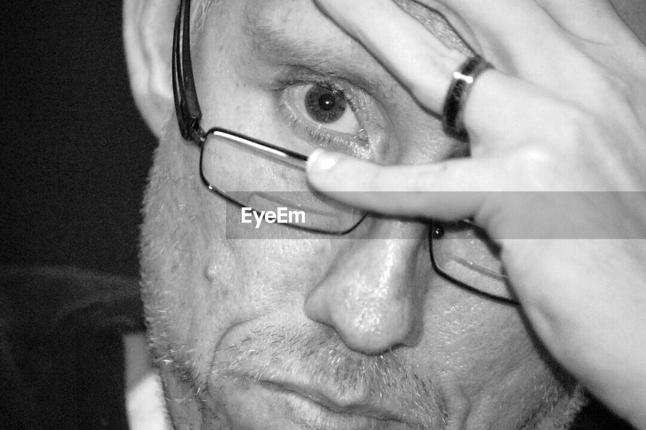 human body part, senior adult, human eye, one person, close-up, human face, eyeglasses, eyesight, indoors, real people, men, human hand, portrait, one man only, eyeball, eyebrow, adult, eye test equipment, adults only, day, only men, people