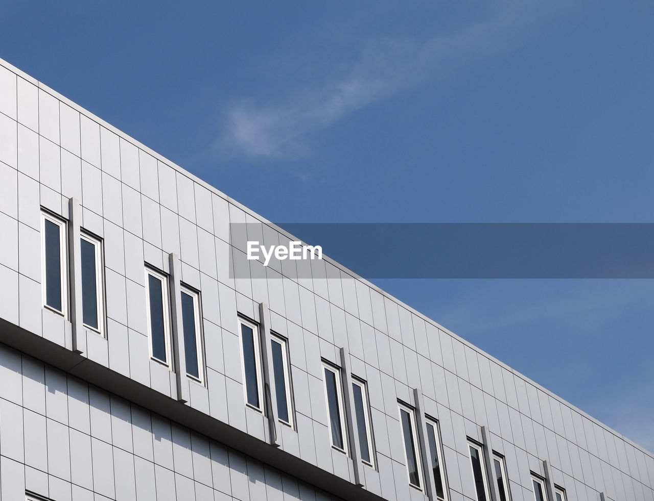 text, communication, day, low angle view, blue, no people, building exterior, architecture, outdoors, built structure, sky